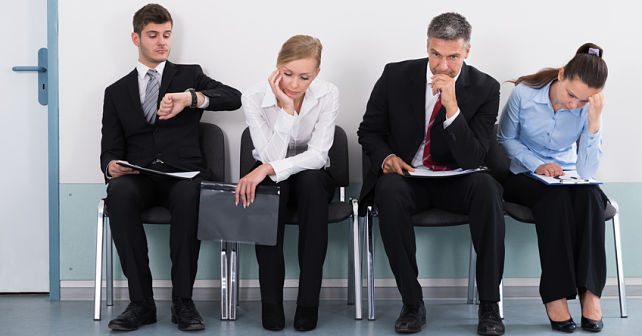 Businesspeople Sitting On Chair Waiting For Job Interview In Office